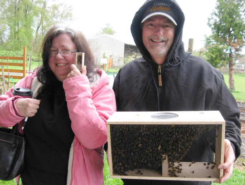 LCBA members Sherri & Randy with their bees & a new queen in her traveling cage