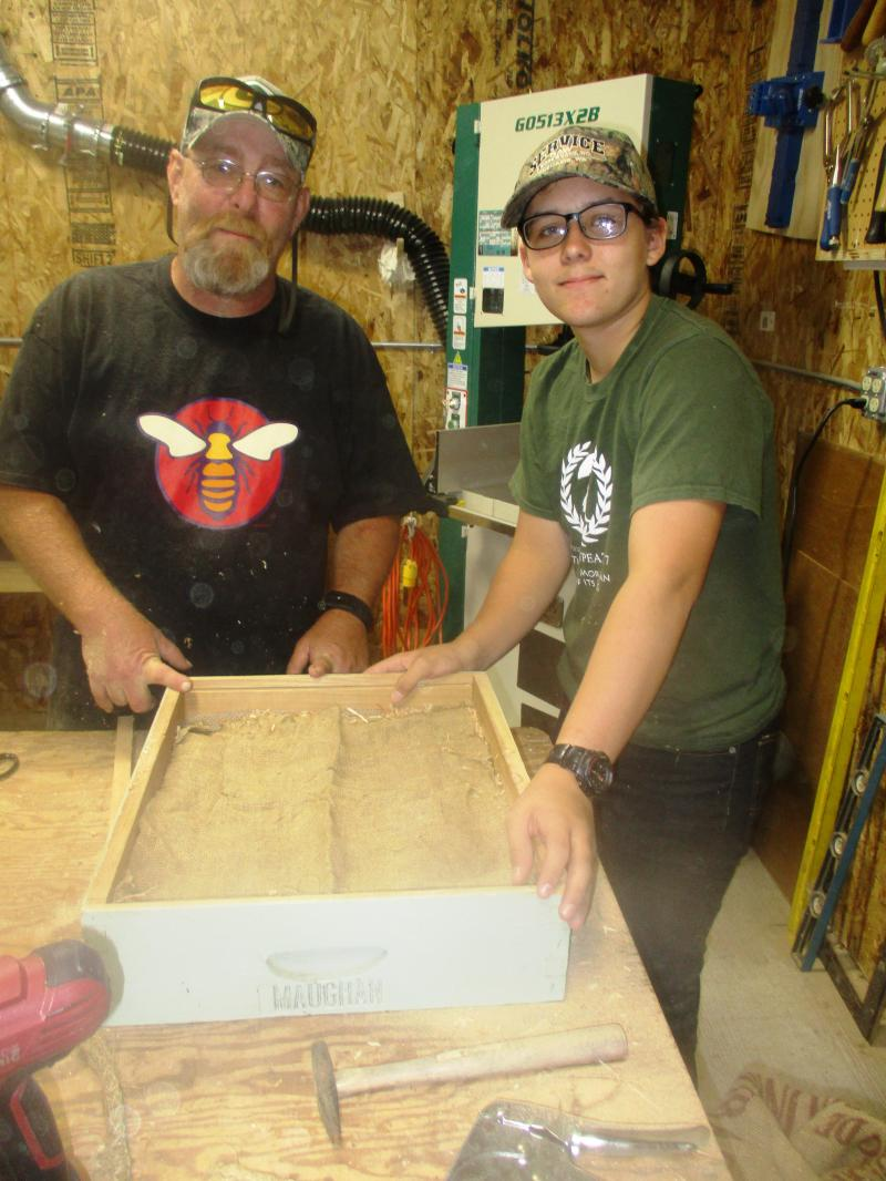 Youth Scholar Adam Claridge and mentor Cody Warren with moisture control box