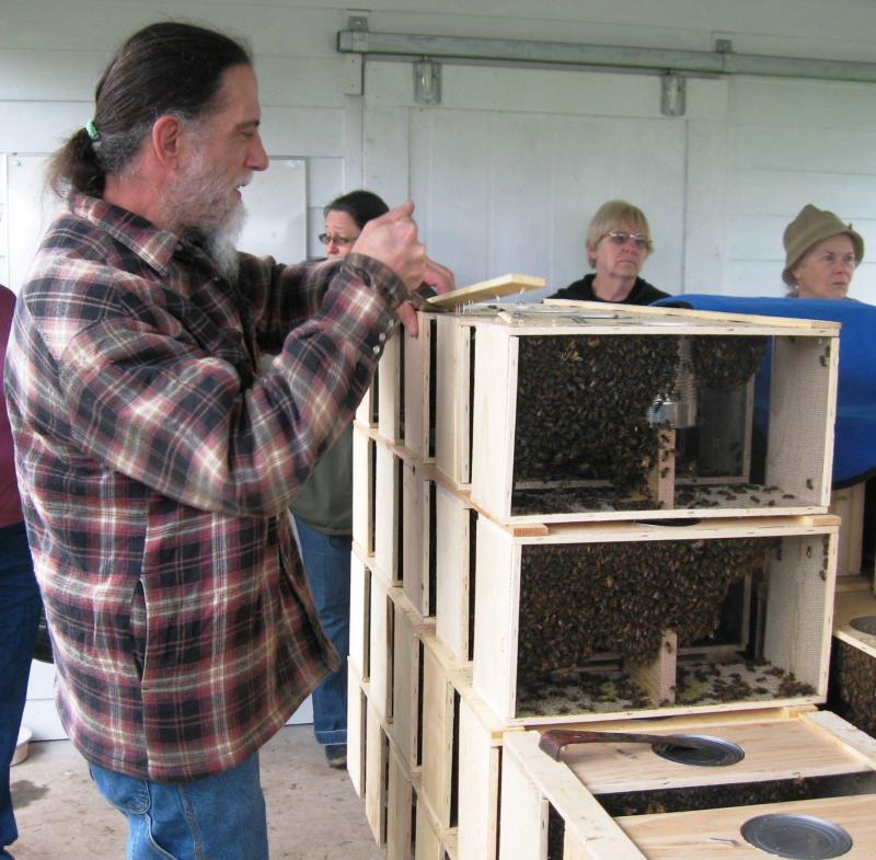 LCBA President Norm Switzler pries packaging bars off package bees