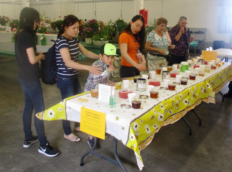Visitors enjoy LCBAs Peoples Choice Honey Tasting