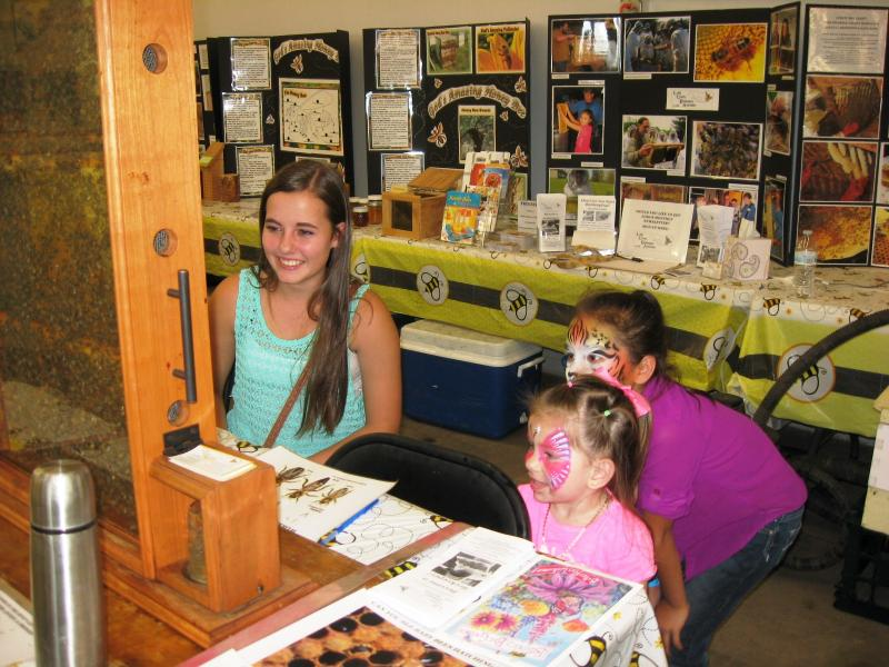 Jana volunteering at LCBAs booth at the Fair