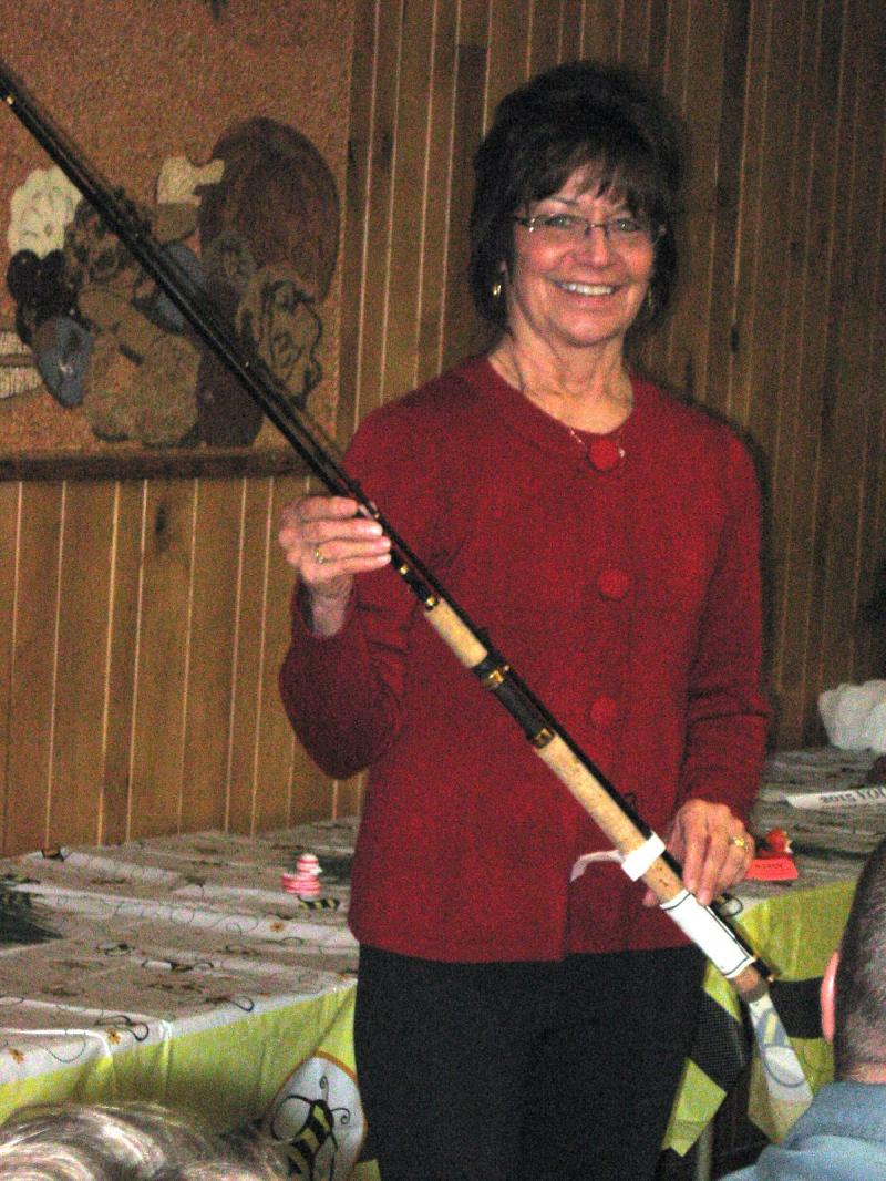 Jeanne Reichert with fishing rod hand-crafted by Herb Keeling