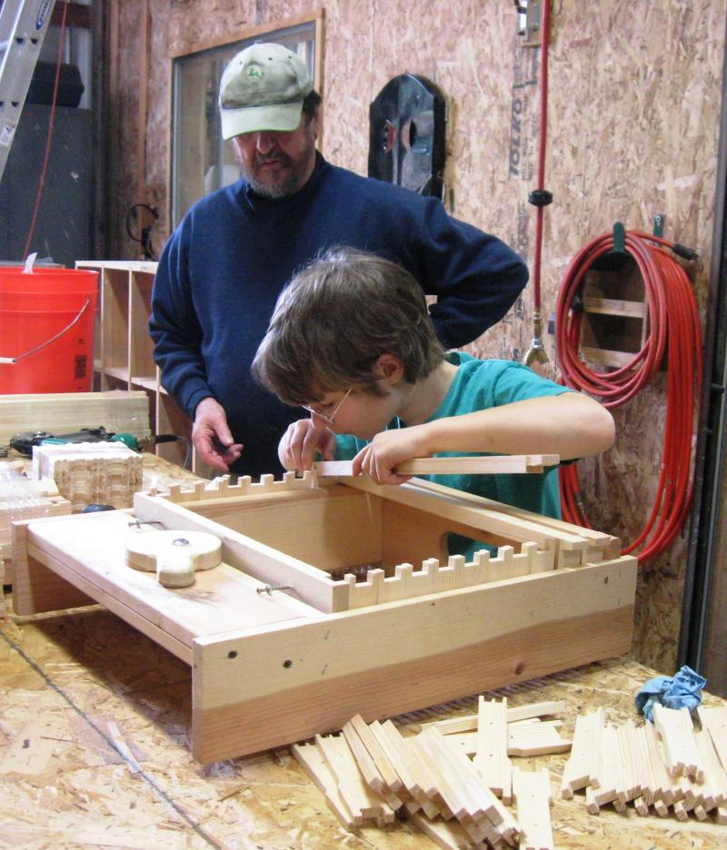 LCBA Youth Scholar Sam assembles frames in a jig
