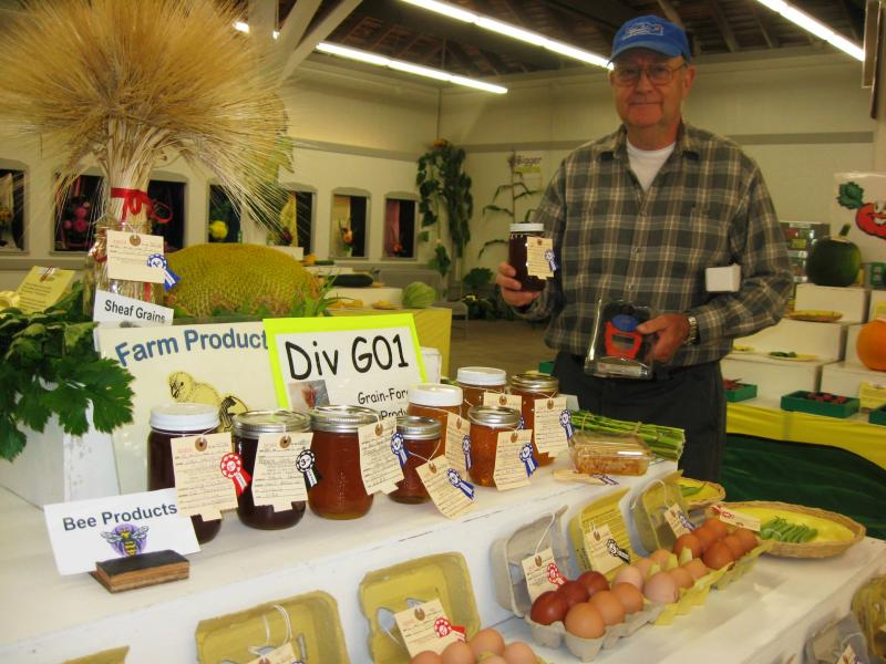 Veteran beekeeper Roy Schaafsma judged honey at the Fair