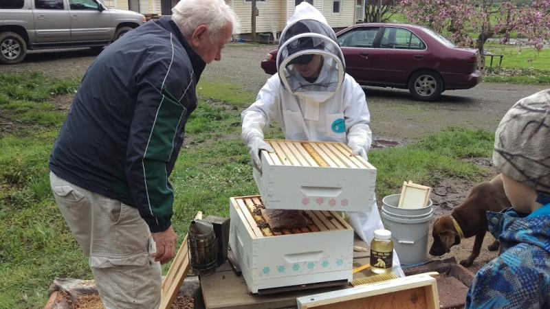 LCBA Youth Scholar Rylea Shan with her bees and Mentor Gottfried