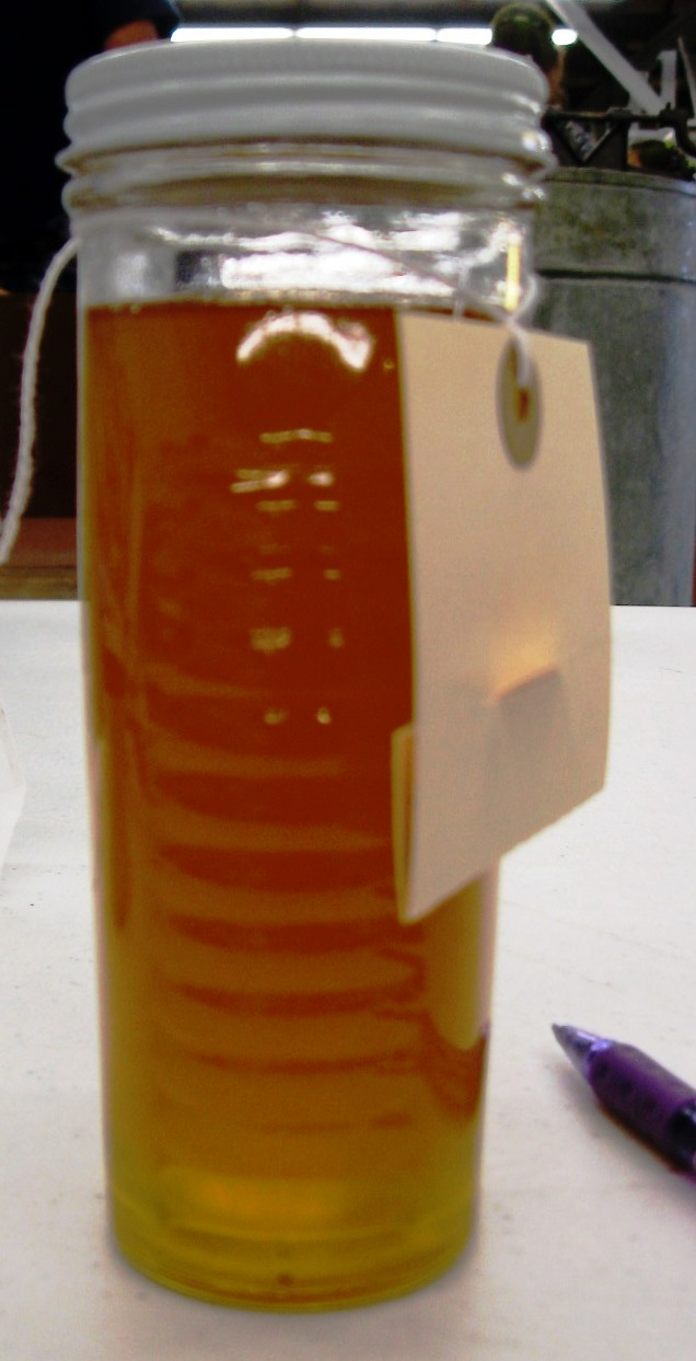 A honey jar not fully filled